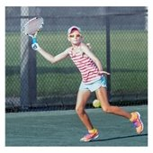 girl with sunglasses and hat playing tennis