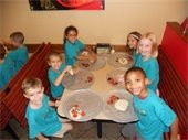 boys and girls making mini pizzas at a School's Out Day program