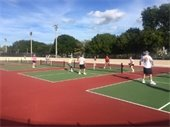 Men and women playing pickleball on the new outdoor pickleball courts