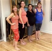 Instructor Beth Green (left) with three female students taking the Pre Natal Yoga Class