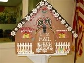 A cottage-shaped, decorated mailbox for letters to Santa