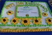 A cake with icing sunflowers from the 13th Anniversary GreenMarket Celebration