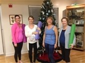 Three ladies and the instructor at Pre Natal Yoga