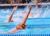 Boys swimming the backstroke in a swim meet