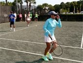 Men and women on the tennis court during a Hitting Frenzy class