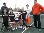 Boys and girls on the Junior Tennis Team with their coaches