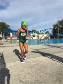 A young girl running from the pool in the Gardens Splash and Dash