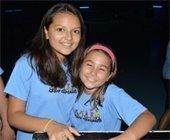 Two girls smiling at Camp Gardens