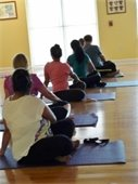 Women and men participating in a Health Yoga class