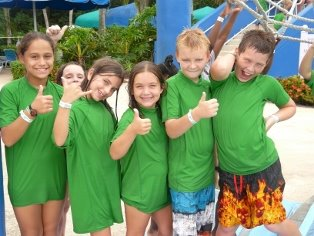 Boys and girls in swim shirts on a field trip