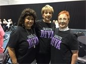 "Three ladies wearing ""Canasta Diva"" t-shirts"