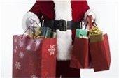 Santa holding multiple gift bags