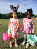 Two little girls holding Easter baskets