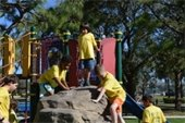 A group of boys climbing on playground equipment