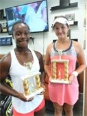 Two girls holding tennis trophies