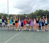A group of men and women in the Tennis Hitting Frenzy class