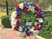A red, white and blue floral wreath