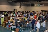 Vendors and shoppers at the Gardens Indoor Yard Sale
