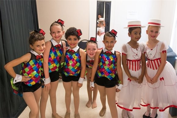Young dance girls in costumes