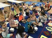 VPK kids sitting on a rug in the classroom