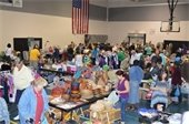 Shoppers and vendors at the Gardens Indoor Yard Sale