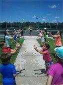 Kids doing a water balloon toss at Tennis Camp