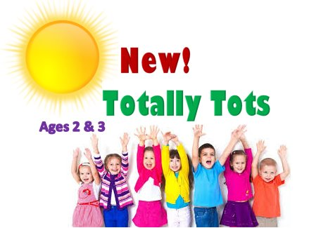 A group of pre-k children with their hands up in the air.