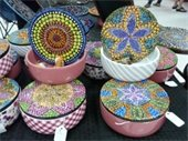 Brightly and intricately painted bowls with lids