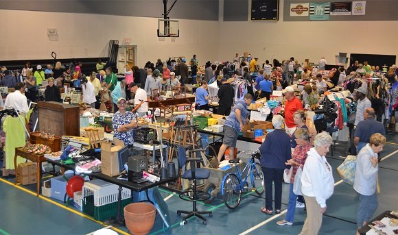 People shopping from a variety of vendors at the Indoor Yard Sale