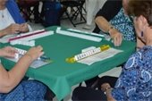Four ladies playing Mah jongg