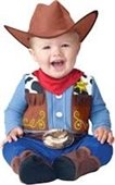 A toddler dressed up in a cowboy costume.