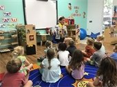 Mayor Maria Marino reading to young children at Riverside Youth Enrichment Center