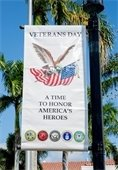A Veterans Day banner hanging from a post