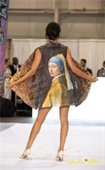 A woman modeling a jacket with a painting of a woman on the back.