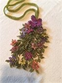 A lariat with flowers and leaves made of tiny beads