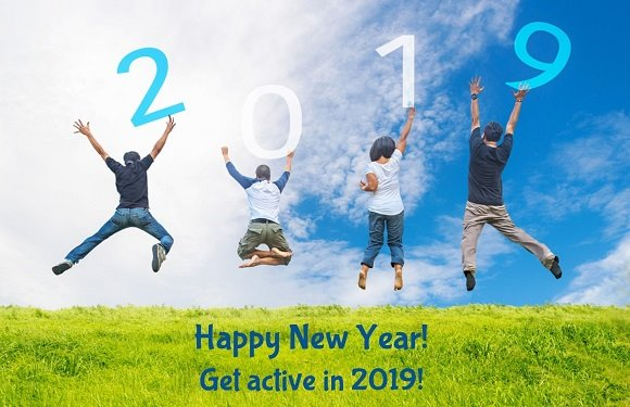 "Four adults jumping in the air with ""2019"" over their heads"