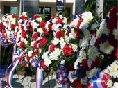 A row of red, white and blue floral wreaths