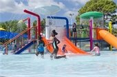 Children playing in the water at the Splash Zone