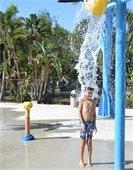 picture of water splashing on boy