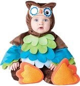 A toddler in an owl costume