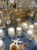 Bottles, candles and vases with seashell decor.