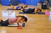Three women doing floor exercises.