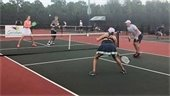 Four Pickleball players on the court.