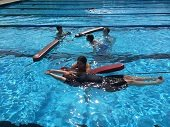 Lifeguard trainees in pool.
