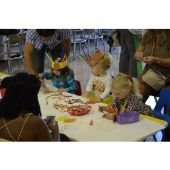 Group of children making crafts at the Wobble Gobble party.