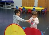 A young boy and girl playing together.