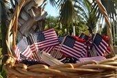 A basket full of handheld American flags.