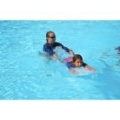 Swimming instructor with student in the pool.