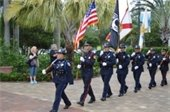 Police and Fire Honor Guard presenting the flags.