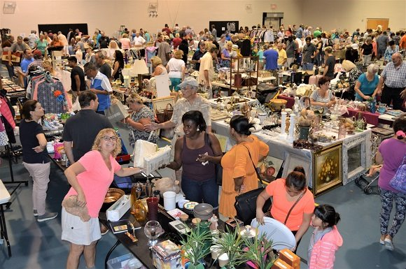 Vendors and shoppers at the Gardens Indoor Yard Sale.